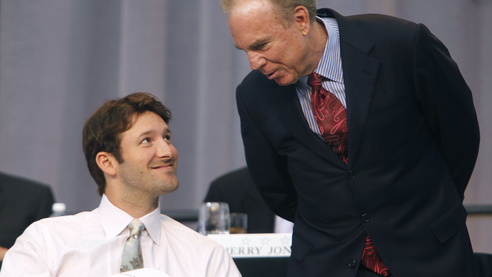 Hall of Fame Cowboys quarterback Roger Staubach (right) and current quarterback Tony Romo visit onstage during the Dallas Cowboys Kickoff Luncheon held at Cowboys Stadium for the first time, Wednesday, September 1, 2010.