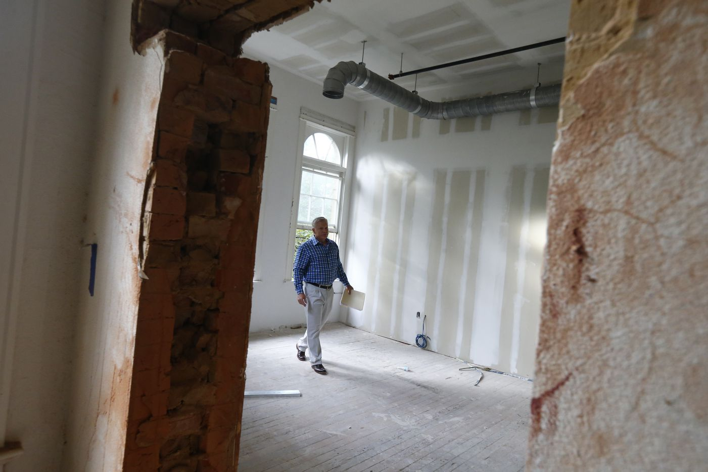 Developer Allan Brown in a room under construction in the historic Davy Crockett School, which is being converted into in apartments in Dallas.
