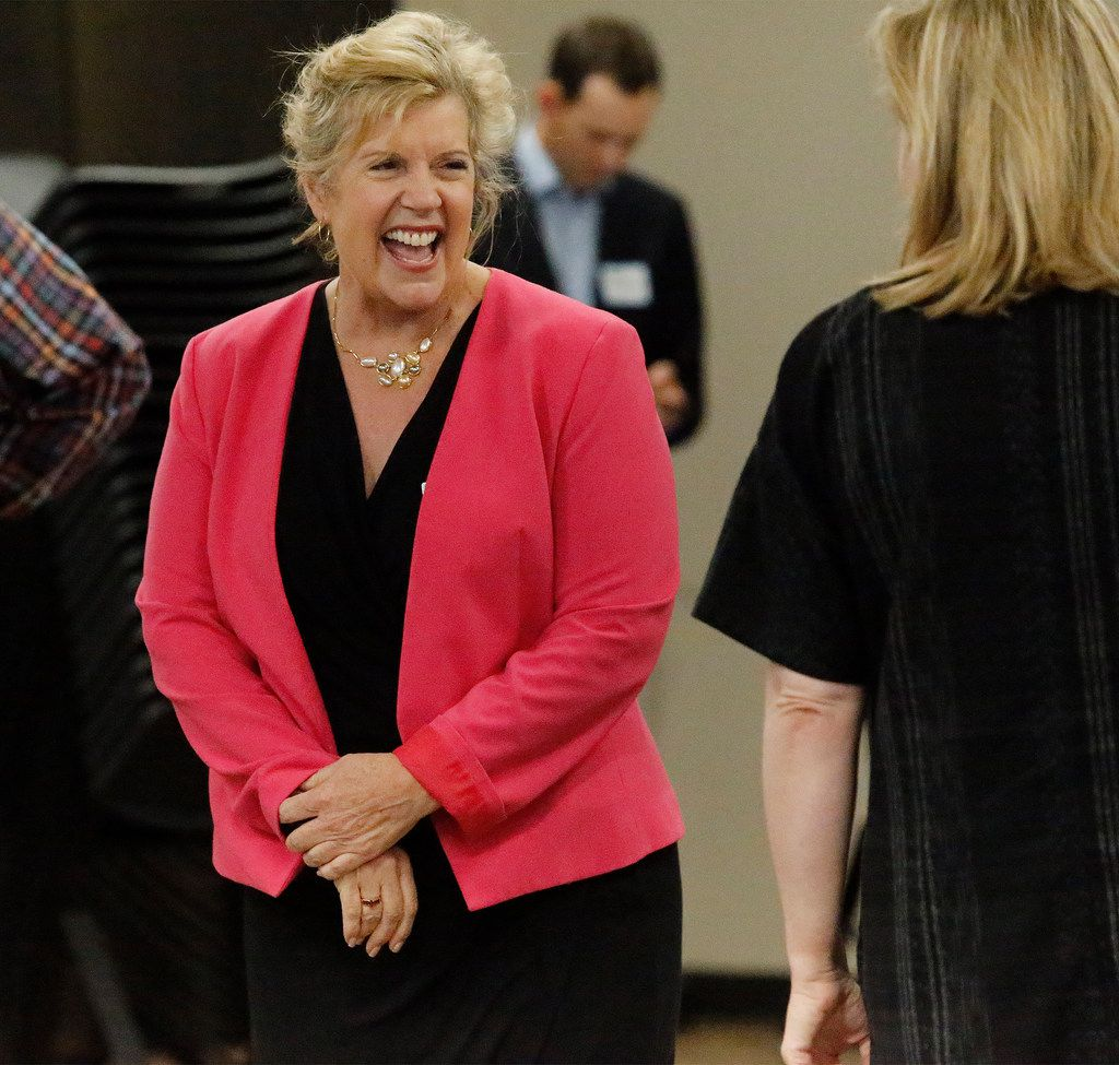 Candidate Lillian Salerno greets guests in attendance before a forum by the North Texas Democratic Jewish Council at Walnut Hill Recreation Center in Dallas on Monday.