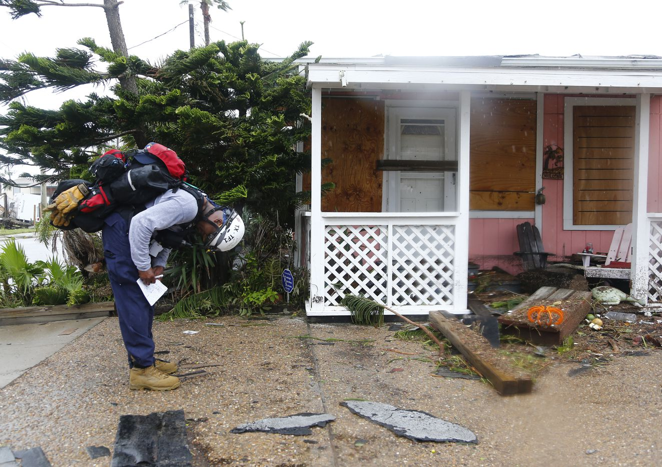 Texas Task Force Search and Rescue Team 1 member Terrance Majors from Fort Worth fills out a tag on a searched house to signal its status after Hurricane Harvey hit Port Aransas, Texas on Aug. 26, 2017.