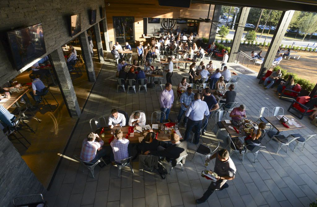 The outdoor patio at the Happiest Hour restaurant and bar that just opened as part of the Harwood area build-out. The 12,000-square-foot venue features 50 draft beers (most of them craft), seven wines on tap and a handful of house cocktails. The space also features a first-floor patio with backyard-style courtyard area and a rooftop terrace with 360-degree views of downtown Dallas. (Robert W. Hart/Special Contributor)