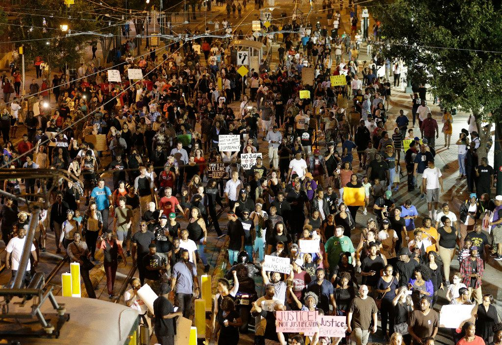 On Sept. 21, demonstrators protested the fatal police shooting of Keith Lamont Scott in Charlotte, N.C.  (AP Photo/Chuck Burton, File)
