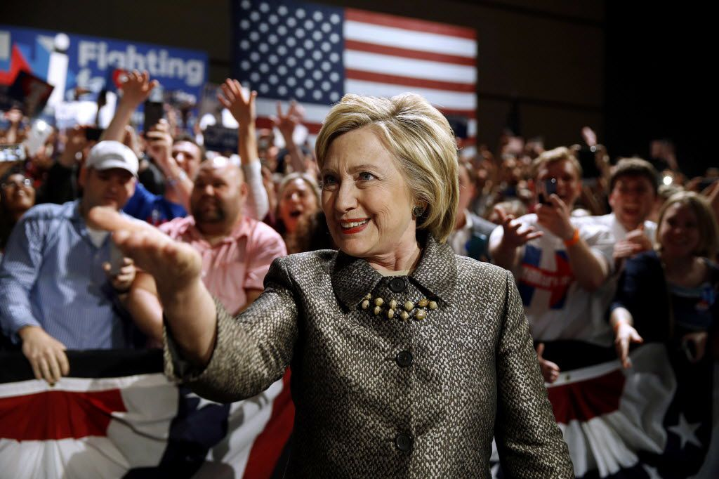 In this April 26, 2016 file photo, Democratic presidential candidate Hillary Clinton moves to the stage at her presidential primary election night rally in Philadelphia. The Texas State Board of Education on Tuesday, Nov. 13, 2018, voted to keep Clinton, Helen Keller and several other historical figures in the curriculum who were slated for deletion. (AP Photo/Matt Rourke, File)