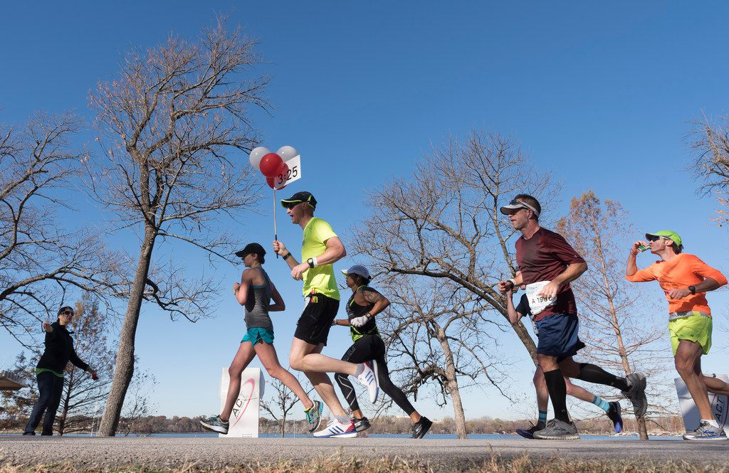 Runners approached the 15.5 mile mark along White Rock Lake during the BMW Dallas Marathon in 2017.