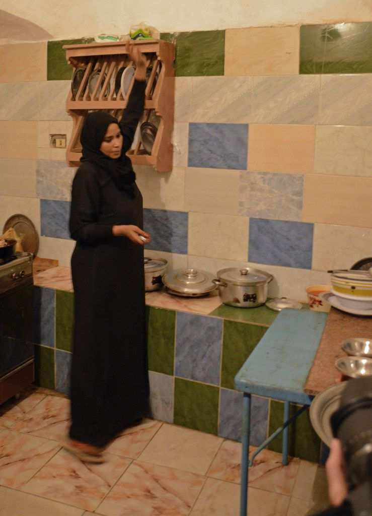 Ashraf Sahloul€™'s wife, Nawal, prepares a meal for a G Adventures tour group.