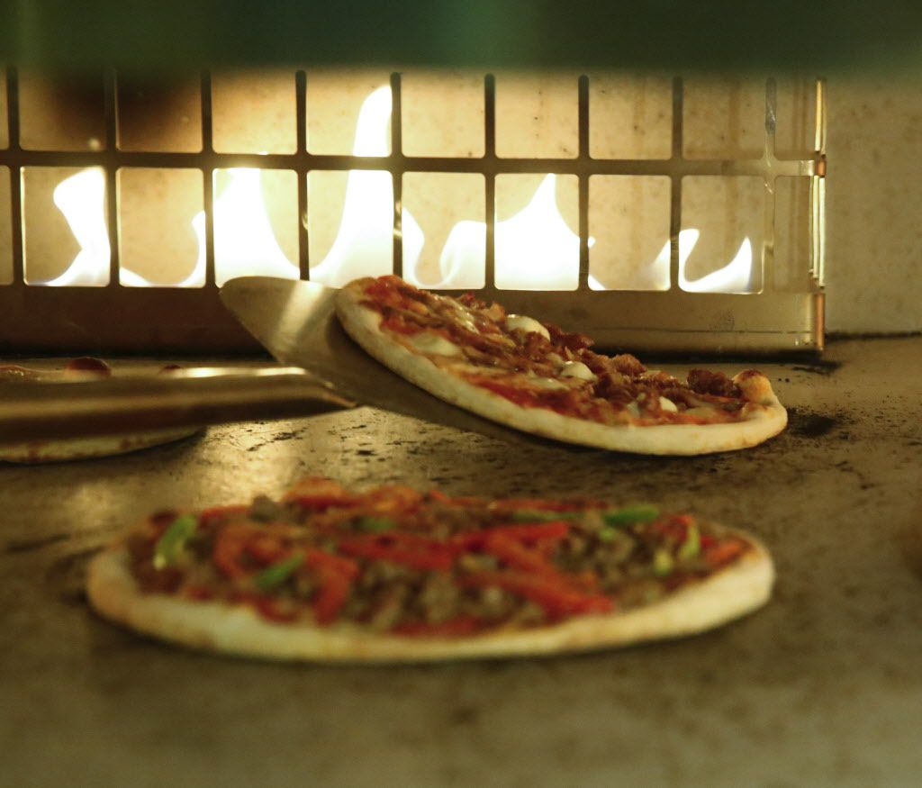 Personal pizza pies are made to order from the lunch menu of the new Coal Vines located across from the Omni Dallas Hotel photographed Monday December 14, 2015.  (Ron Baselice/The Dallas Morning News)