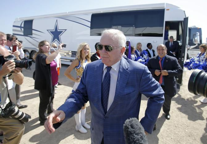 """Cowboys owner Jerry Jones, followed by Mayor Maher Maso and schools Superintendent Jeremy Lyon, walks from a team bus to the site of Friday's groundbreaking for a multi-use event center and the Cowboys' new headquarters. Maso said the project is coming together step by step: """"Every day I look at something new out here, and I say, 'Wow!' """""""