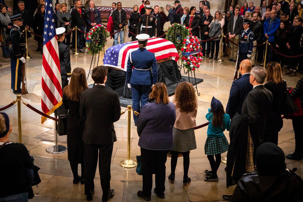 Members of the public file past the flag-draped casket of President George H.W. Bush as he lies in the Rotunda of the U.S. Capitol on Tuesday, Dec. 4, 2018, in Washington.