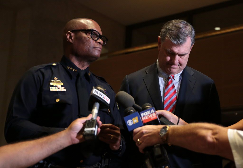 Dallas Police Chief David Brown and Mayor Mike Rawlings address the media at City following Thursday's shooting of 11 police officers in downtown Dallas, July 7, 2016. Four officers are confirmed dead as of 11:45pm Thursday.
