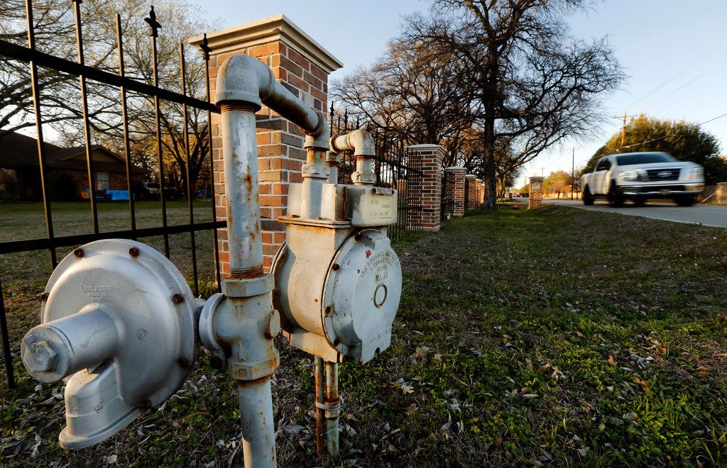 An older style gas meter sits in the right-of-way along South Pearson Lane in Keller.