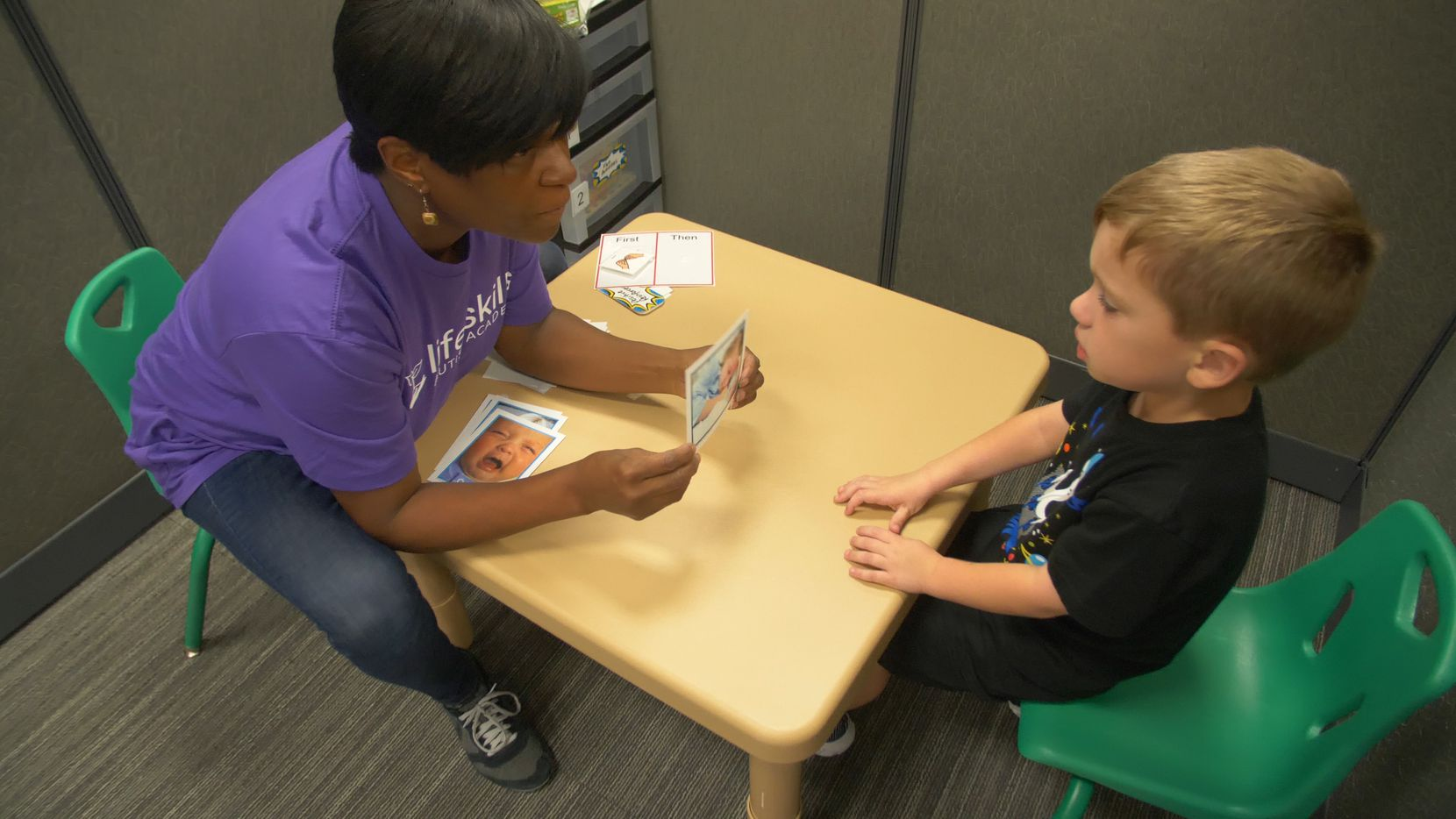 A therapist provides one-on-one lessons for a Life Skills Autism Academy client.