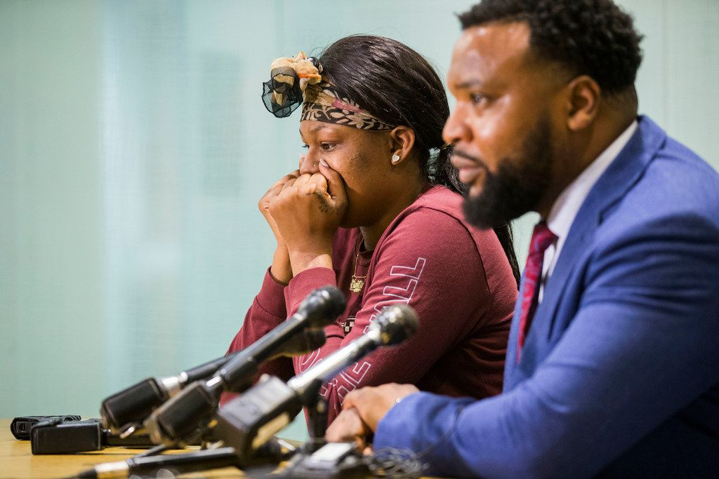 L'Daijohnique Lee, left, with her lawyer, civil rights attorney Lee Merritt, during a press conference in Dallas on Monday, March 25, 2019. Lee was allegedly attacked Thursday morning by Austin Shuffield, not pictured, in Deep Ellum. (Daniel Carde/The Dallas Morning News)