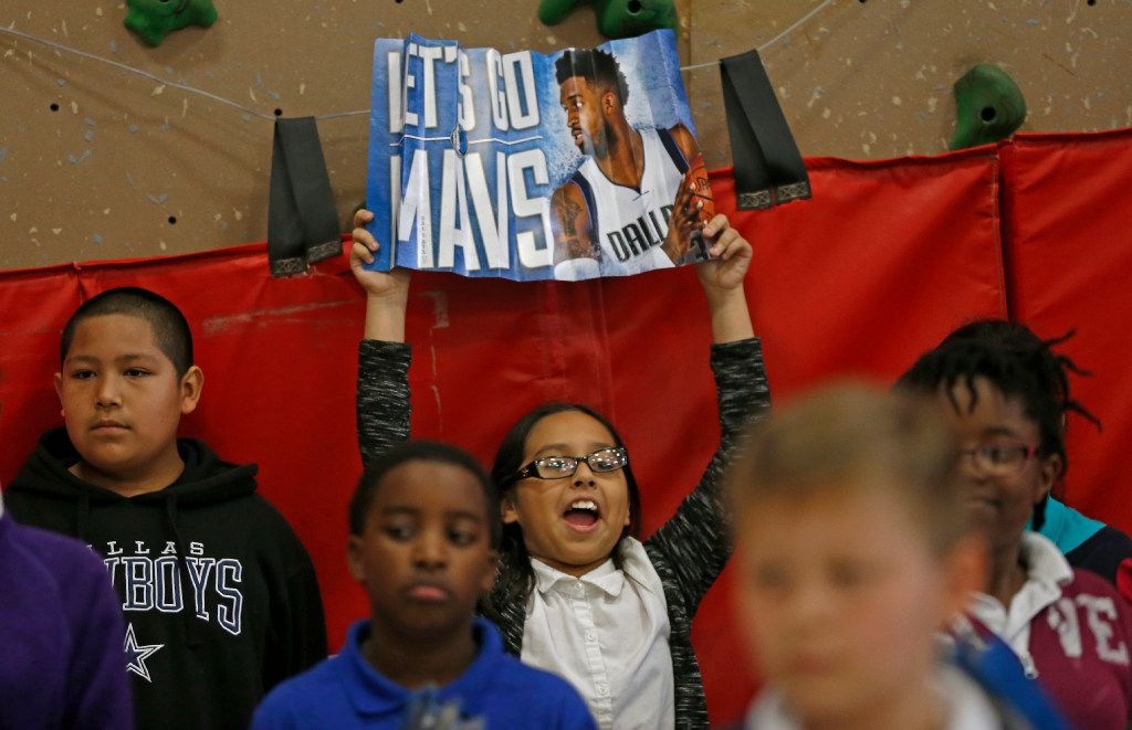 Kendra Martinez, a fifth-grader at Florence Elementary, flashed a poster of Matthews at Thursday's event. (Jae S. Lee/Staff Photographer)