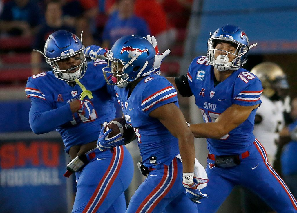 SMU safety Mikial Onu (4) is congrautaled by his teammates defensive back Jordan Wyatt (15) and defensive lineman Demerick Gary (10) after he makes an UCF interception during the first quarter at Gerald J. Ford Stadium on Saturday, Nov. 4, 2017, in Dallas. (Jae S. Lee/The Dallas Morning News)
