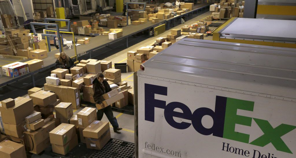 A 2014 study by the National Multifamily Housing Council found that only a quarter of apartment complexes used specialized software to track package deliveries and that parcel carriers leave packages with apartment managers when residents aren't home 70 percent of the time. (File Photo/The Associated Press)