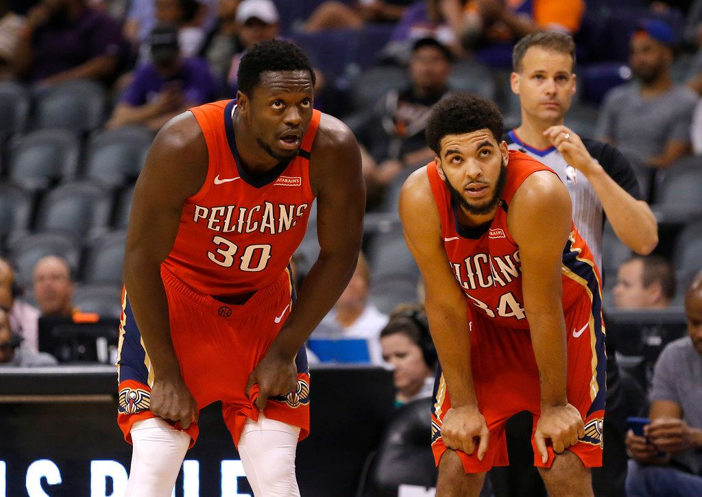 New Orleans Pelicans center Julius Randle (30) and Kenrich Williams (34) in the first half during an NBA basketball game against the Phoenix Suns, Friday, April 5, 2019, in Phoenix. (AP Photo/Rick Scuteri)