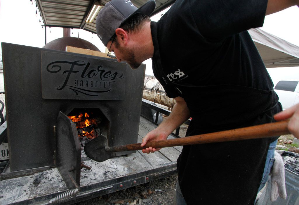 Doug Summers tends to the fire for one of the large pits as customers patiently wait in a line outside the business during the final weekend before Flores Barbecue closes their doors and move the business to Tarrant County. The popular restaurant is moving to Fort Worth where they will initially re-open the business before moving into a true restaurant in the early summer of 2020. Pitmaster and owner Michael Wyont and his staff served loyal customers at Flores Barbecue in Whitney during their final weekend of business. Some of his loyal customers waited up to an hour in line for his famous barbecue and share their well wishes on Saturday February 2, 2019 (Steve Hamm/ Special Contributor)
