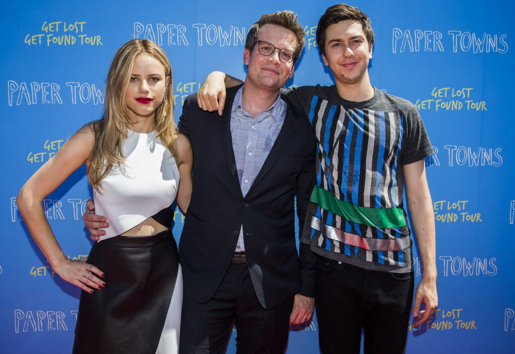 Actress Halston Sage, author John Green and actor Nat Wolff pose for photos on the red carpet outside a promotional event for Paper Towns, a movie based on the book by John Green, on Thursday, July 16, 2015 at Bomb Factory in Dallas
