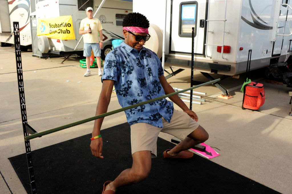 Aaron Jackson attempts the limbo at the Jimmy Buffett tailgate party at Toyota Stadium in Frisco, TX on May 30, 2015.