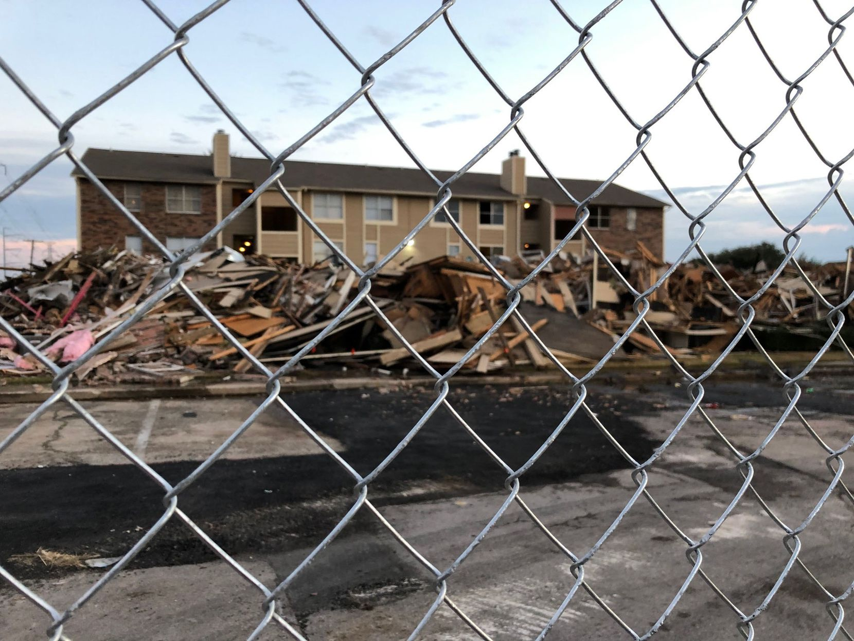 The burned Meadows at Ferguson Building F was demolished Wednesday afternoon.