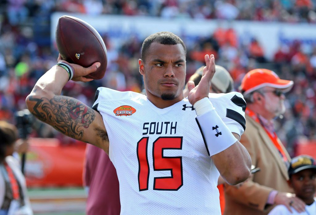 Jan 30, 2016; Mobile, AL, USA; South squad quarterback Dak Prescott of Mississippi State (15) throws on the sidelines in he first quarter of the Senior Bowl at Ladd-Peebles Stadium. Mandatory Credit: Chuck Cook-USA TODAY Sports