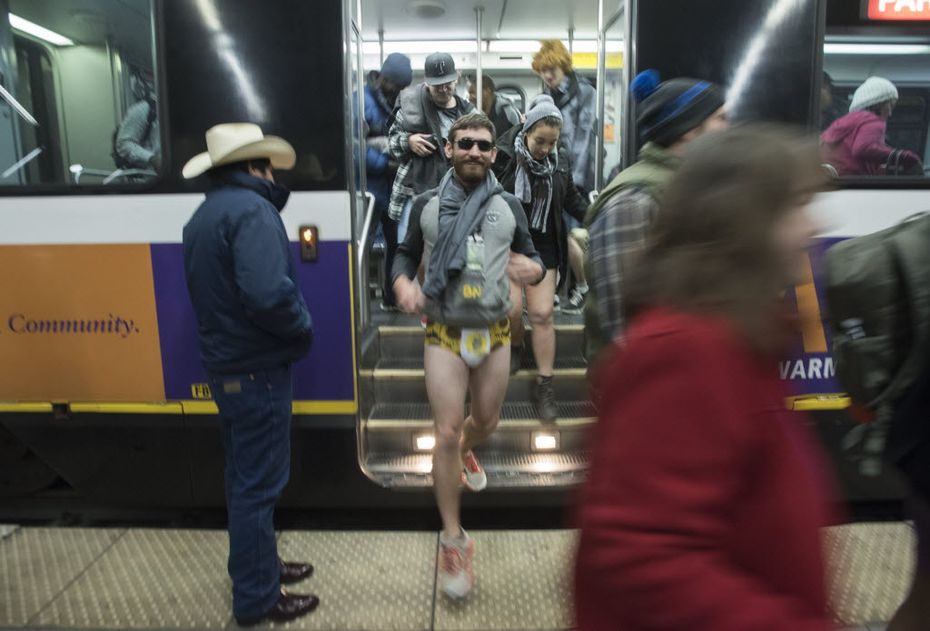 Dart riders exit the train at Cityplace/Uptown Station in their underwear during the No Pants Subway Ride Dallas event on Sunday, Jan. 10, 2016.