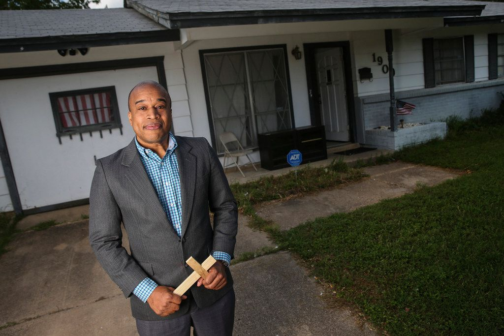Emmanuel Lewis, standing in front of his Irving home, has seen his house's value increase almost 50% in five years.