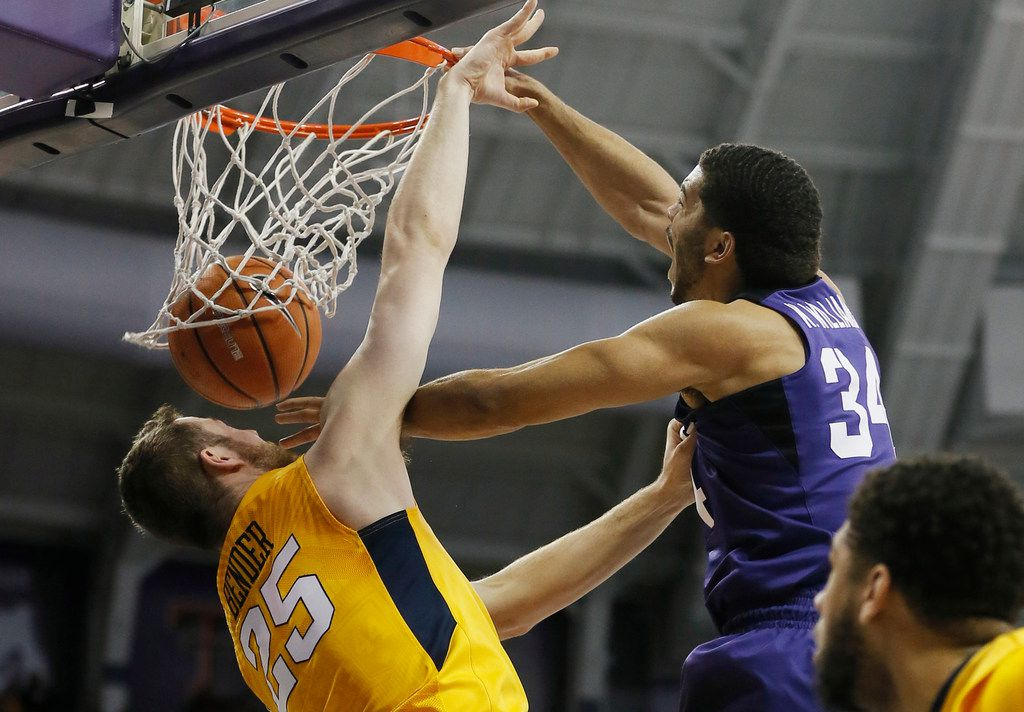 TCU guard Kenrich Williams (34) dunks as West Virginia forward Maciej Bender (25) defends during the first half of an NCAA college basketball game at TCU, Monday, Jan. 22, 2018 in Forth Worth, Texas. (Brandon Wade/Fort Worth Star-Telegram/TNS)