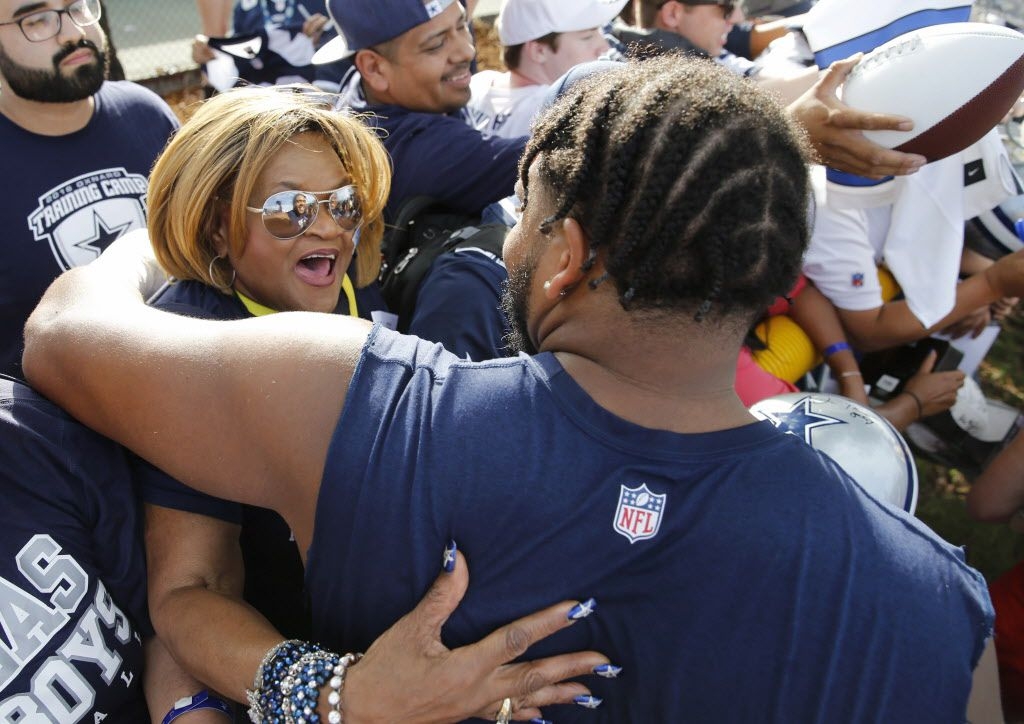 Carolyn Price gets a hug from Dallas Cowboys offensive guard La'el Collins (71) after the afternoon practice at training camp in Oxnard, California on Monday, July 24, 2017. (Vernon Bryant/The Dallas Morning News)