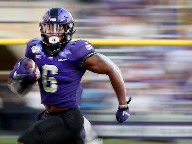 FORT WORTH, TEXAS - SEPTEMBER 21: Darius Anderson #6 of the TCU Horned Frogs carries the ball against the Southern Methodist Mustangs in the second half at Amon G. Carter Stadium on September 21, 2019 in Fort Worth, Texas. (Photo by Tom Pennington/Getty Images)