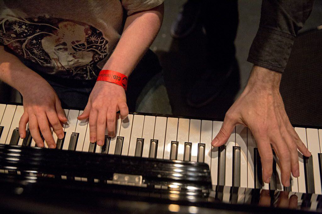 "Ben Schneider (left) is joined at the piano by Ben Folds as he plays the instrument on stage following a sound check at the Majestic Theater Thursday, April 14, 2016 in Dallas. Schneider, 11, who is both blind and autistic, learned to play Folds' song ""Sky High"" and considers the musician a hero. He was given the chance to meet Folds during an event for VIP's before his show Thursday night at the downtown Dallas venue. (G.J. McCarthy/The Dallas Morning News)"