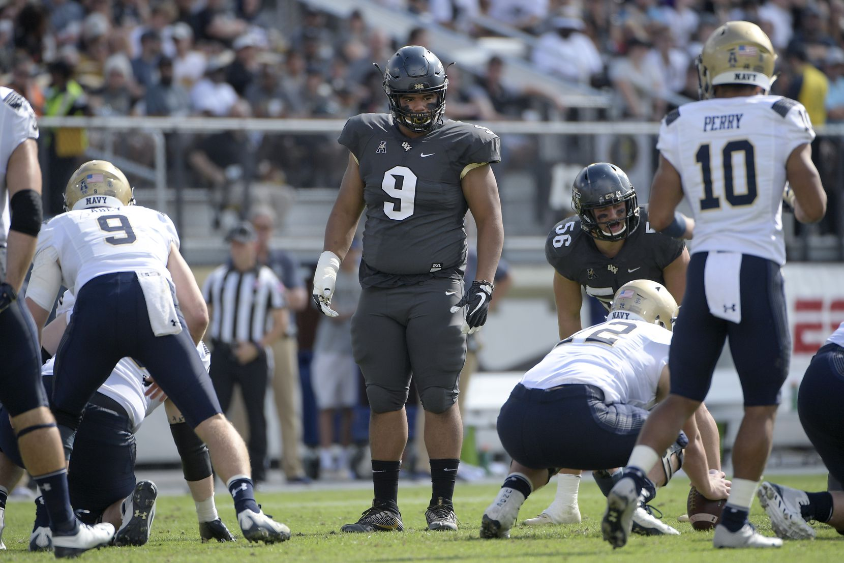 Central Florida defensive lineman Trysten Hill (9) sets up for a play during the first half of an NCAA college football game against Navy Saturday, Nov. 10, 2018, in Orlando, Fla. (AP Photo/Phelan M. Ebenhack)