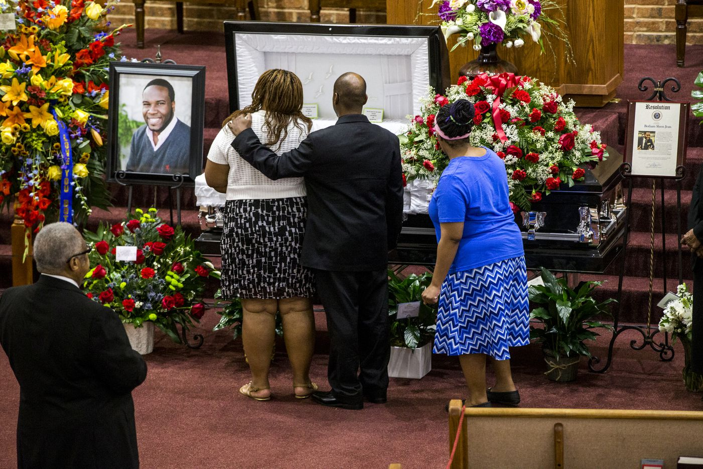 Mourners console each other during the public viewing before the funeral of Botham Shem Jean at the Greenville Avenue Church of Christ on Thursday, September 13, 2018 in Richardson, Texas. He was shot and killed by a Dallas police officer in his apartment last week in Dallas. (Shaban Athuman/ The Dallas Morning News)