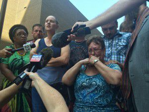 Nicole Hutcheson, left, and Ruth Boatner, bottom right, were among family members who spoke during a news conference outside the Dallas County jail on Friday, Aug. 14, 2015. (Naomi Martin, DMN)