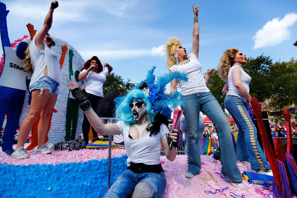 Revelers on a float dance and perform on the AVEN float during the Alan Ross Texas Freedom Parade, Sunday, September 17, 2017.