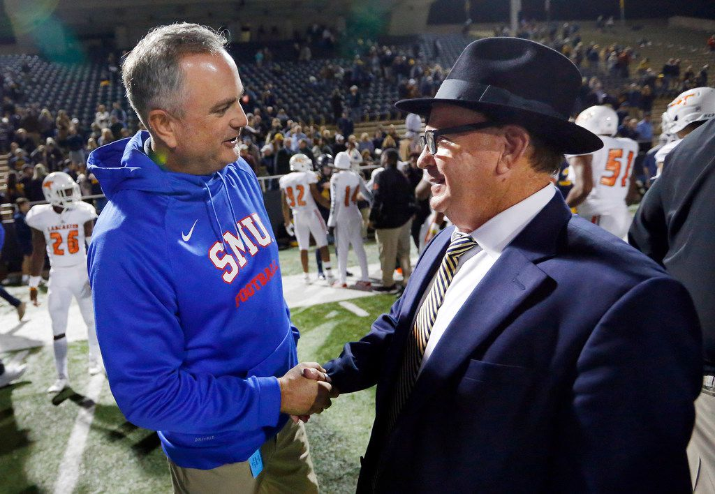 Highland Park head football coach Randy Allen (right) is congratulated on his win by SMU head football coach Sonny Dykes following their win at Highlander Stadium in Highland Park, Texas, Friday, November 2, 2018. Highland Park won, 39-14. (Tom Fox/The Dallas Morning News)
