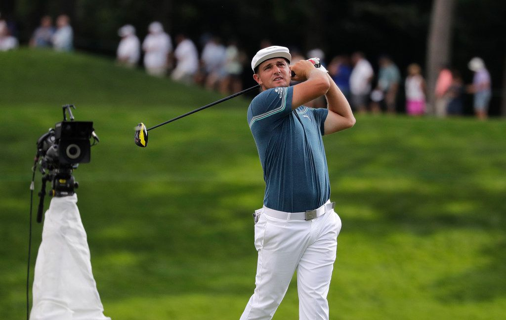 Bryson DeChambeau watches his tee shot on the 18th hole during the second round of the BMW Championship golf tournament at Medinah Country Club, Friday, Aug. 16, 2019, in Medinah, Ill. (AP Photo/Nam Y. Huh)