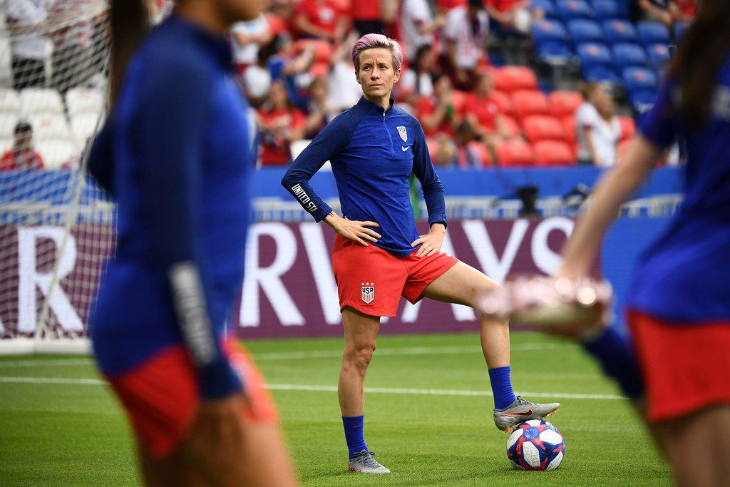 TOPSHOT - United States' forward Megan Rapinoe looks on during warm up prior to the  France 2019 Women's World Cup semi-final football match between England and USA, on July 2, 2019, at the Lyon Satdium in Decines-Charpieu, central-eastern France. (Photo by FRANCK FIFE / AFP)FRANCK FIFE/AFP/Getty Images