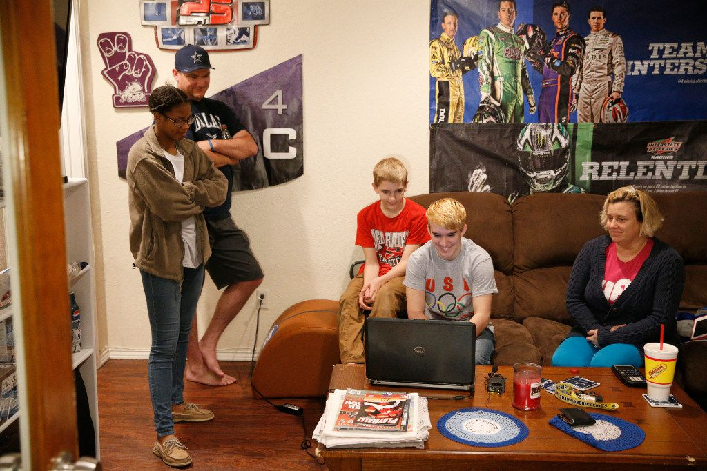 Mack Beggs (in front of computer), state wrestling champion and 17-year-old transgender student from Euless Trinity, during an interview on Skype with  friend, D'Shaylyn August, 17, (from left) his father, Damon McNew, brother, Harley McNew, 13, and mother Angela McNew, at his home in Hurst, Texas, on February 28, 2017.  (Nathan Hunsinger/The Dallas Morning News)