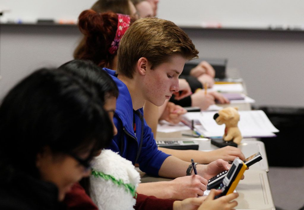 Noah Pearson, junior at Townview's Talented and Gifted (TAG) High School, works on a P-AP Pre-Calculus problem with classmates in Thelvie Cullins and Valeria Perez's classroom on Friday, December 16, 2016. (David Woo/The Dallas Morning News)