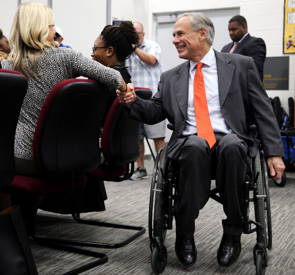 Governor Greg Abbott greets Jesse Helms, a math teacher at Annie Webbs Blanton Elementary School during a meeting with with teachers and school administrators during a visit to Dallas ISD Solar Preparatory School for Girls on Tuesday, August 21, 2018 in Dallas. (Ryan Michalesko/The Dallas Morning News)