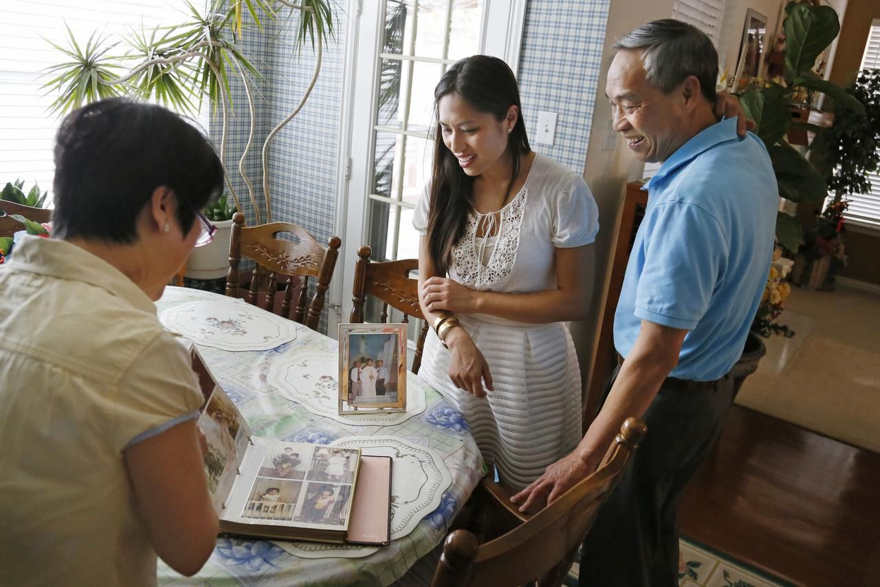 Mary Nguyen shared photos  with husband Thomas and daughter Teresa (center) at their home in Fort Worth. Mary and Thomas' four children have grown and moved out, and all had the opportunity for good educations that Thomas Nguyen dreamed about and worked toward.