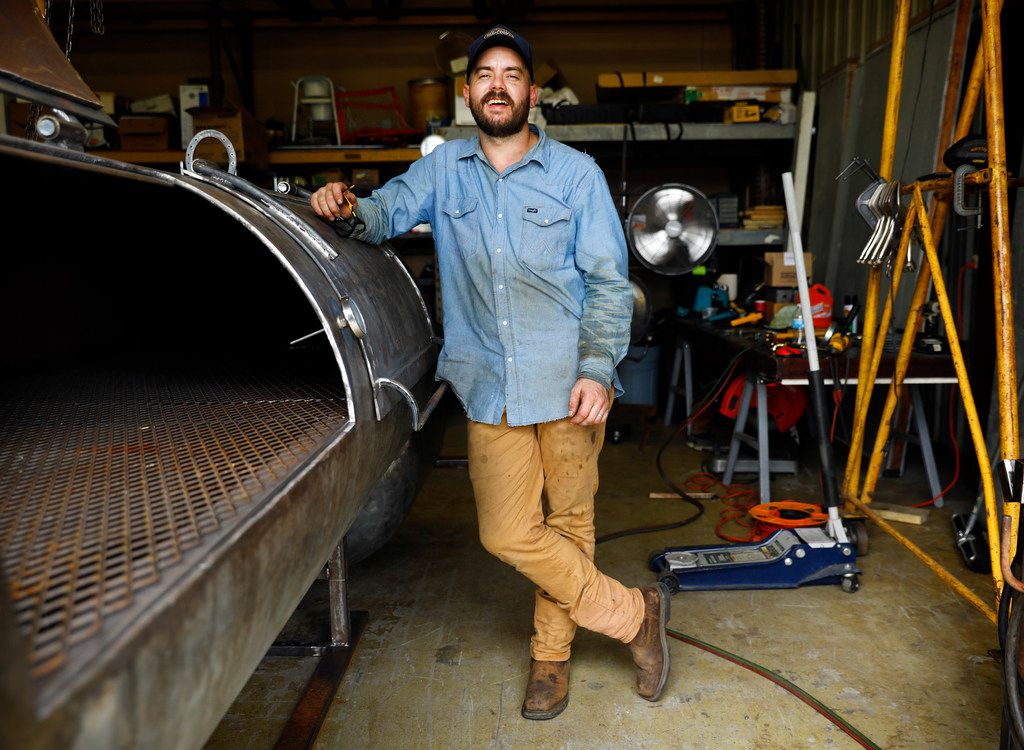 Guess Family Barbecue owner and pitmaster Reid Guess takes a break from welding on a 500-gallon smoker in Waco. Guess says he grew up making barbecue pits and smoking meat.