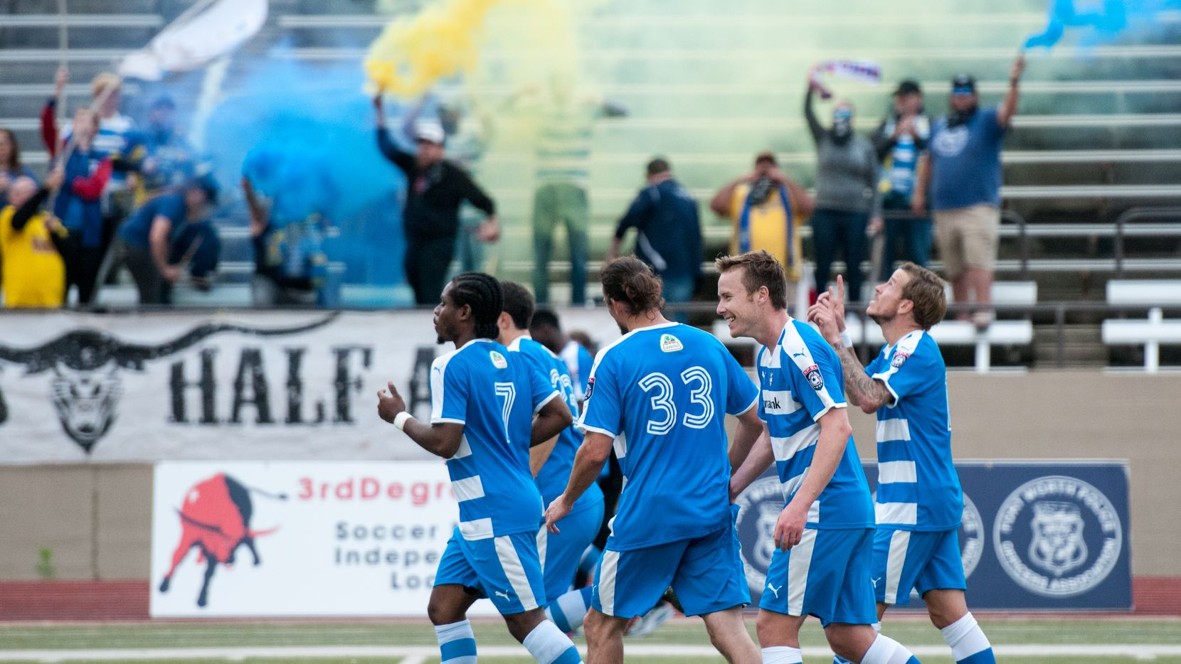 Fort Worth Vaqueros celebrate a goal at Farrington Field.
