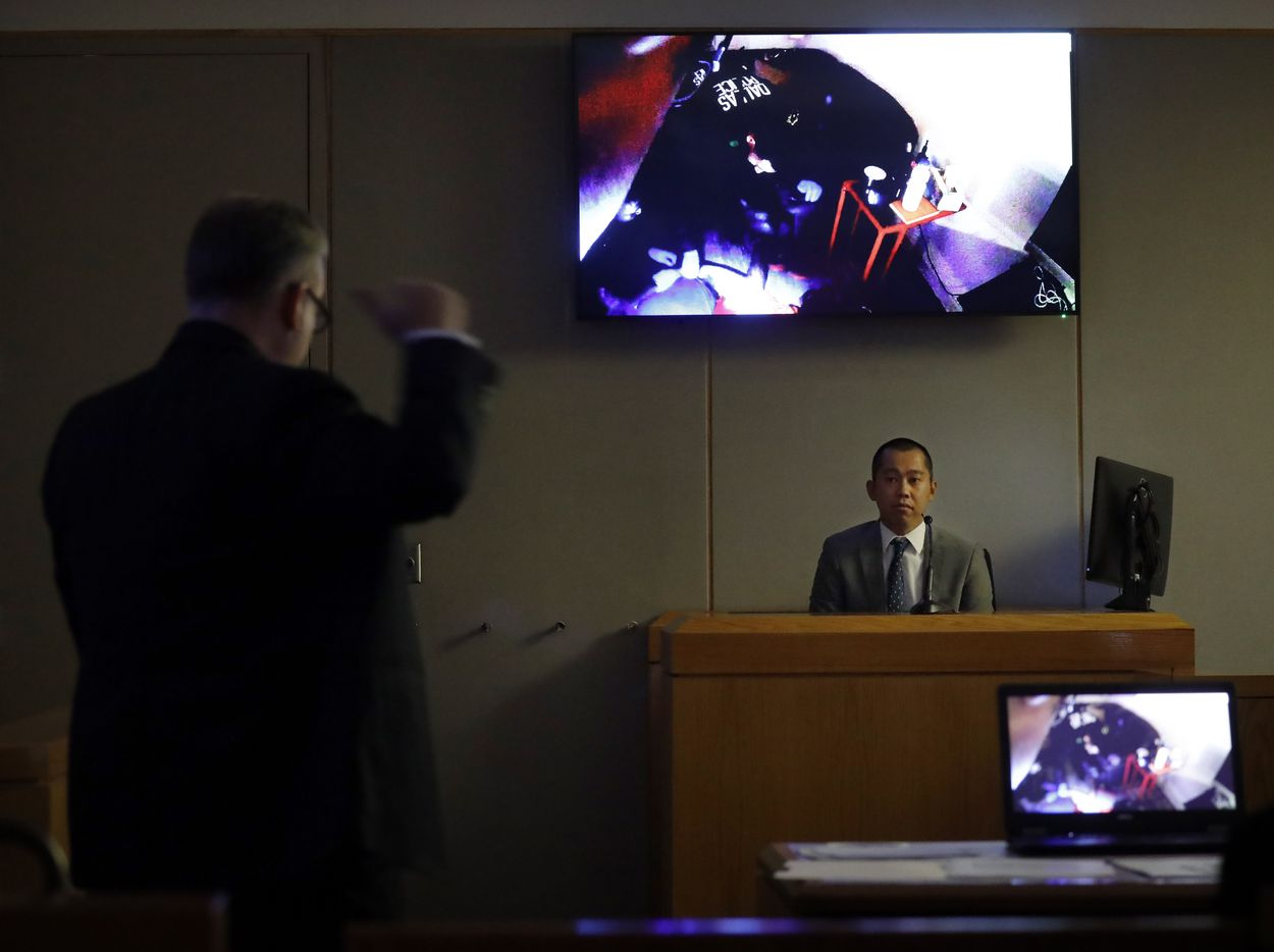 Dallas police officer Tu Nguyen is questioned by Assistant District Attorney Jason Hermus (left) as his body camera video inside Botham Jean's apartment was shown in the 204th District Court at the Frank Crowley Courts Building in Dallas, Thursday, September 26, 2019.