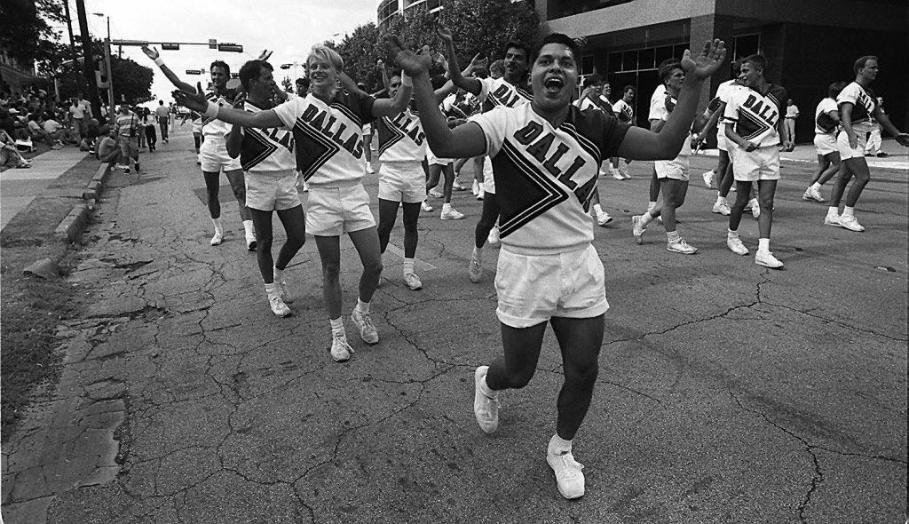Marc Morin, center, cheers with  Cheer Dallas as the group marches down Cedar Springs with the 11th annual Alan Ross Texas Freedom Day Parade on Sept. 25, 1994.