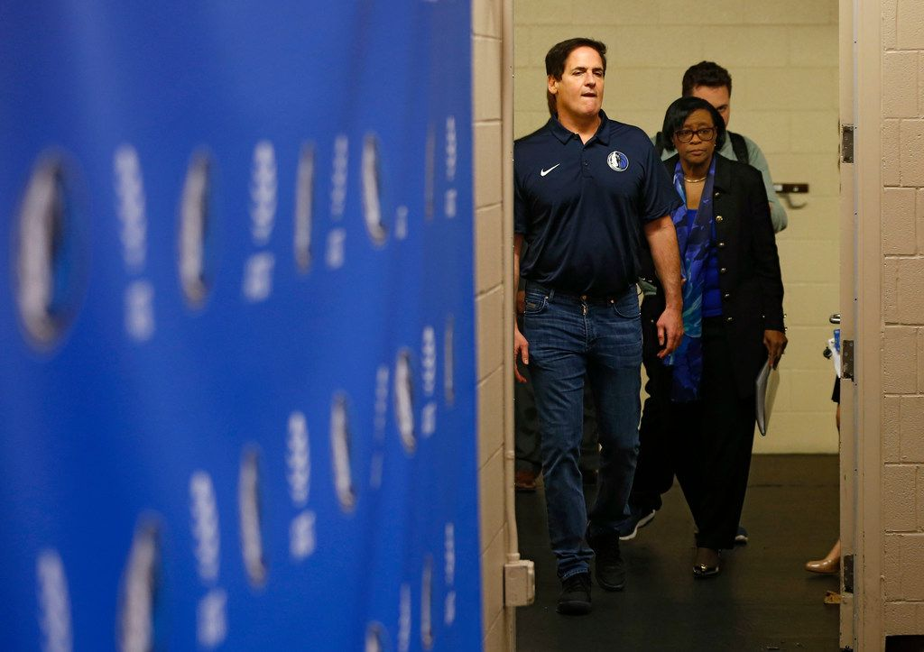 Dallas Mavericks owner Mark Cuban  and Dallas Mavericks interim CEO Cynthia Marshall maker their way into the room for a press conference at American Airlines Center in Dallas on Monday, February 26, 2018. Marshall has been hired by the Mavericks to help clean up after the recent sexual harassment scandal in the front office. (Vernon Bryant/The Dallas Morning News)