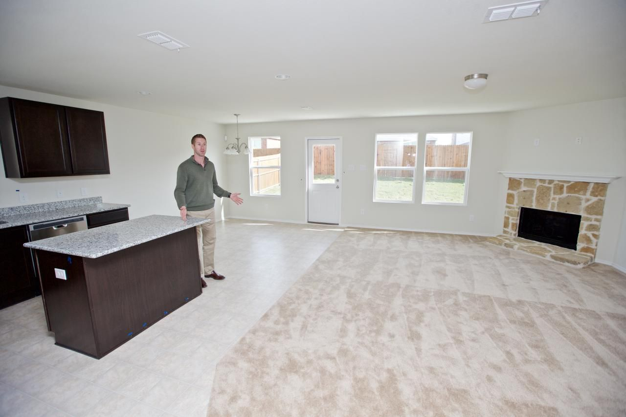 """Centex Plute Homes General Sales Manager Mike Goza show cases the kitchen and living room area of the 1,641 sqft """"Rosemont"""" floor plan in the Paloma Creek South neighborhood in Little Elm, Friday, November 6, 2015. The Rosemont currently starts at $190,990."""