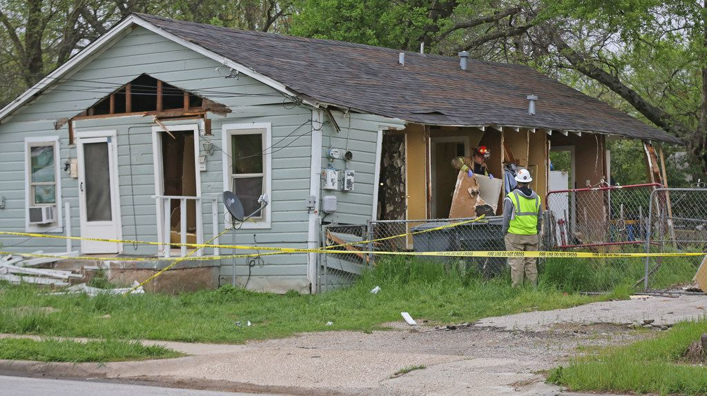 Officials investigate a house explosion at 3700 Spring Avenue in Dallas, near Fair Park, on Monday, April 2, 2018.