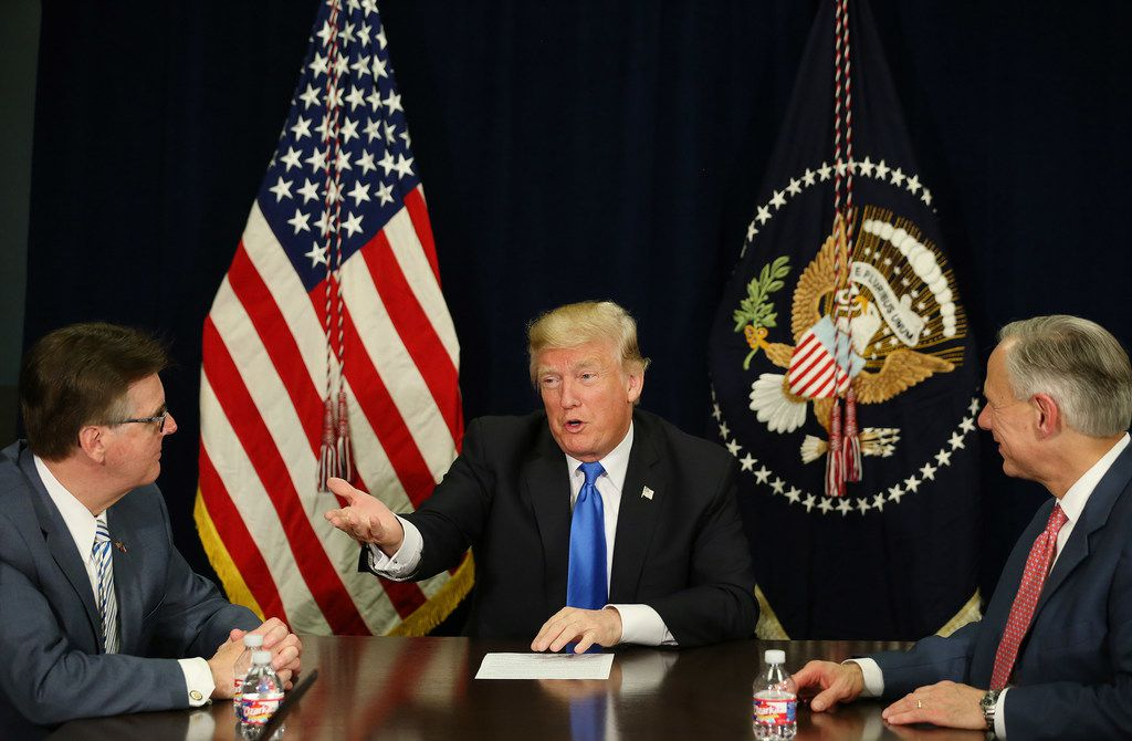 President Donald Trump speaks as Texas Lt. Gov. Dan Patrick and Texas Gov. Greg Abbott listen during a hurricane response briefing at Signature Flight Support near Love Field in Dallas Wednesday October 25, 2017. President Trump participated in a hurricane recovery briefing, a Republican National Committee roundtable and gave remarks at a reception.